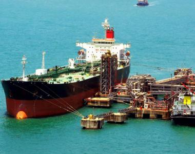 Merchant ship loading at dock