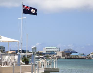 Dock with the Cayman flag flying